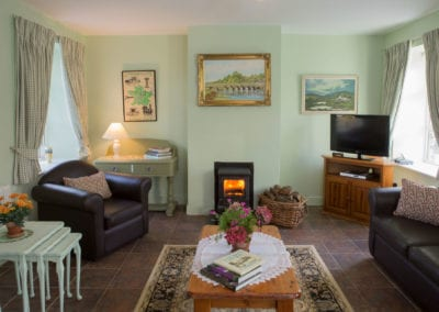 Living Room Coffee Table Cushions Sofa Fireplace Kindling Logs Wood Wicker Basket Cottage House Holiday-Homes-Ireland-Meath-Dunshaughlin Self Catering